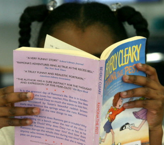 close up of girl reading book